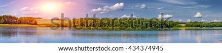 Landscape of a beautiful lake at dusk panorama - stock photo