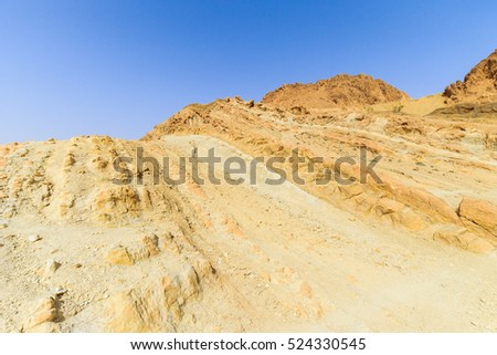 Landscape of a canyon in stone desert. Sahara gorge at sunny day.