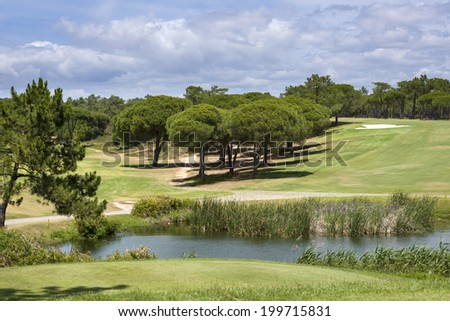 Landscape of a golf course on the coastline of Portugal, Vilamoura - stock photo
