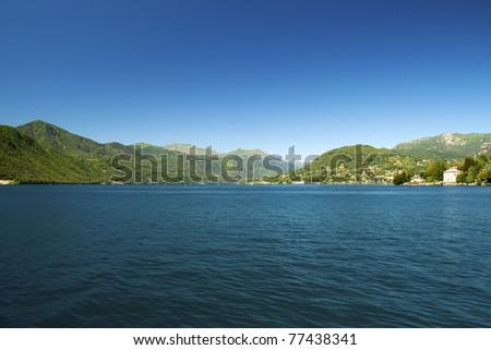 Landscape of a lake under a blue sky - stock photo