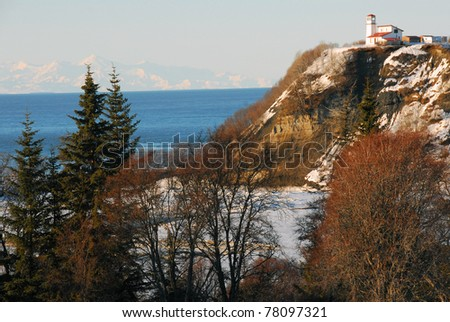 Landscape of a lighthouse on the coast of the Cook Inlet in Ninilchik, Alaska on the Kenai peninsula - stock photo