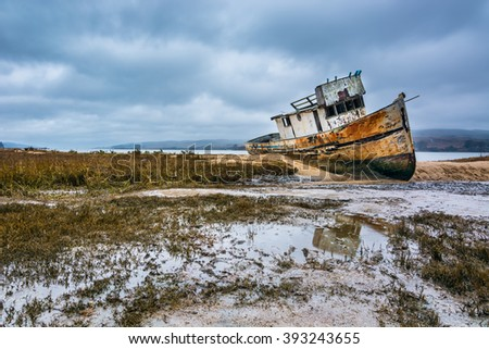 Landscape of a shipwreck with Its reflection at Point Reyes National Seashore, California.  Point Reyes is located at north of San Francisco, California.  Point Reyes is also known as wildlife habitat - stock photo