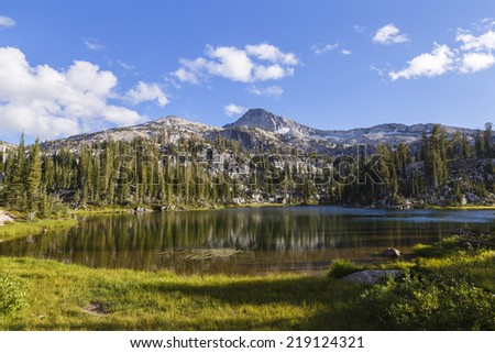 Landscape of a small pond and granite mountain in the background - stock photo