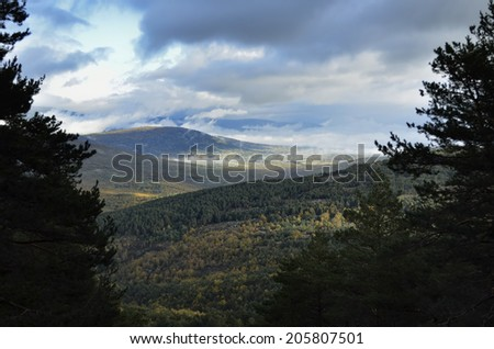 Landscape of a sunrise with clouds on the mountain