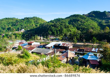 Landscape of a village with mountain in tropical rainforest. - stock photo