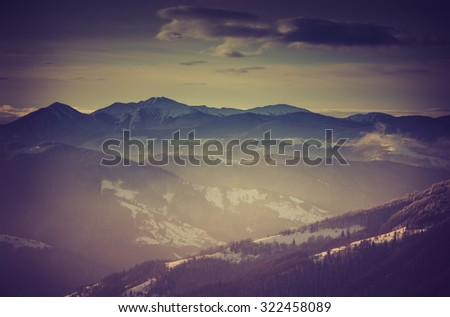 Landscape of amazing evening winter in mountains. Fantastic evening glowing by sunlight. Retro filter and instagram toning effect.    - stock photo