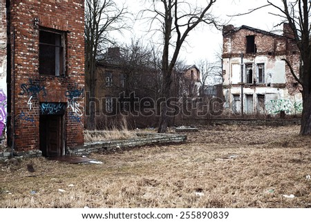 Landscape of an abandoned village ruined houses - stock photo