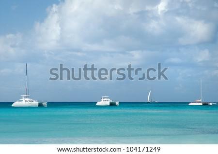 Landscape of Atlantic Ocean. Caribbean paradize. White pleasure boat - catamaran - stock photo