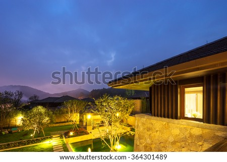 landscape of backyard in modern building near pond  in blue sky at night
