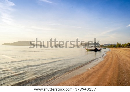 Landscape of beach and boat in the sea with morning mist background - stock photo