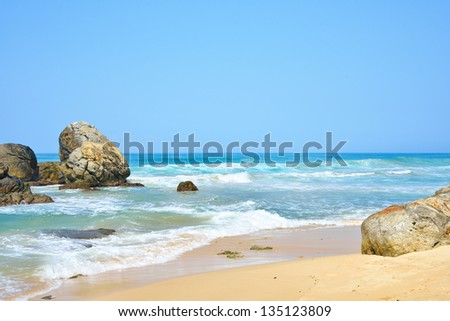 Landscape of beach, tropical sea and stones