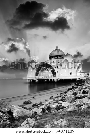 Landscape of beach wit floating mosque on water in Malacca, Malaysia, Asia. - stock photo