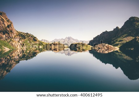 Landscape of beautiful Lake with Rocky Mountains reflection Summer Travel serene minimalistic view  - stock photo