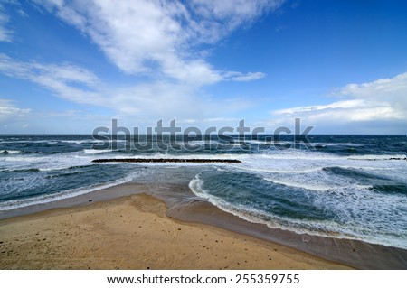 landscape of blue sky and dramatic sea - stock photo