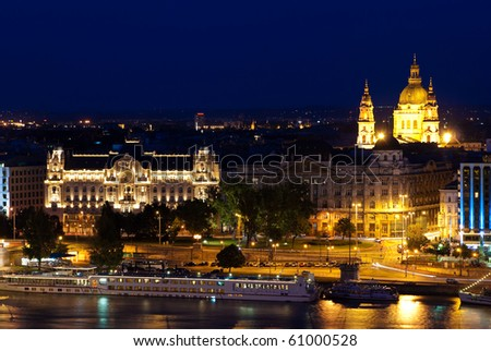 Landscape of Budapest in night, with the Gresham palace in foreground and the Szt. Istvan Church in background