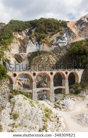 Landscape of Carrara's marble quarry in Tuscany (Italy) with the distinctive bridge in the locality Ponti di Vara - stock photo