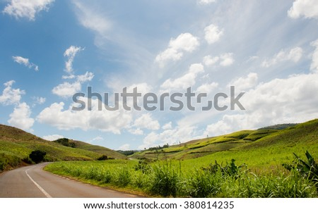 Landscape of Chamarel, sugar cane fields. Blue Sky with white clouds