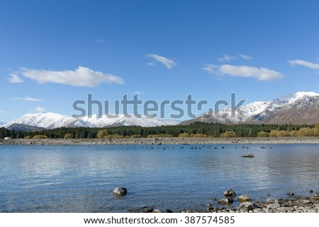 Landscape of cloudy with blue sky all around the lake and a snow mountain background