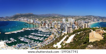 Landscape of coastline with beaches, yachts, city under the bright sun (Coast Spain, Calpe) - stock photo