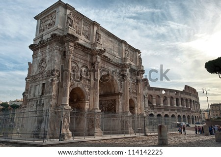 Landscape of Colosseum and Arch of Constantine in Rome - stock photo