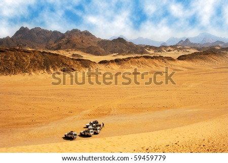 Landscape of desert with jeep ready for safari. - stock photo