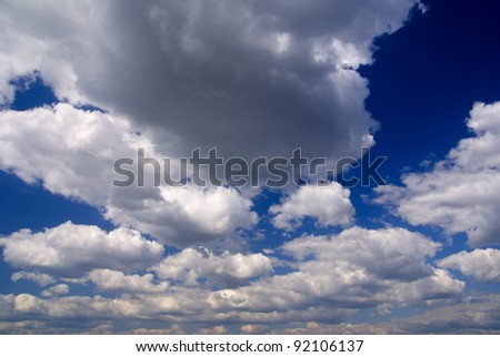 landscape of dramatic blue sky with fluffy clouds