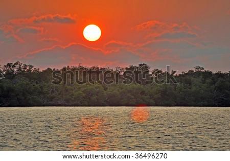 landscape of florida wetlands on barrier island at sunset - stock photo
