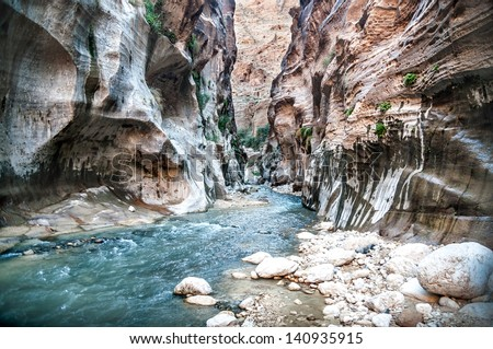 Landscape of flowing water of creek in Wadi Hasa, Jordan