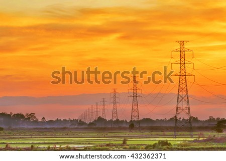 Landscape of HDR electric pole at sunset twilight - stock photo