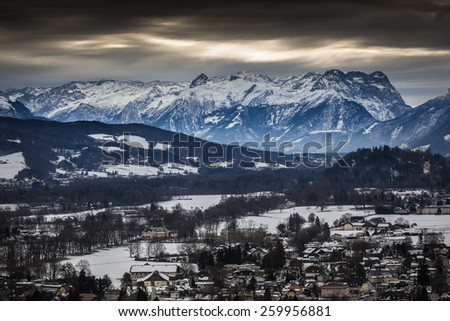 Landscape of high Alps near Salzburg covered by snow at cloudy day