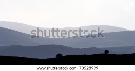 landscape of hills through the fog in spain - stock photo