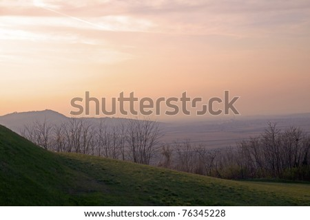 Landscape of hills under sky at the sunset - stock photo