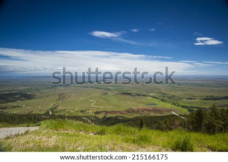 Landscape of huge, flat plateau, prairie in Wyoming, USA. - stock photo