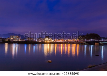 Landscape of inuyama city view with kiso river in night time.