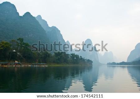 Landscape of Li River in Winter, Guilin, China - The Li River or Lijiang is a river in Guangxi Zhuang Autonomous Region, China. - stock photo