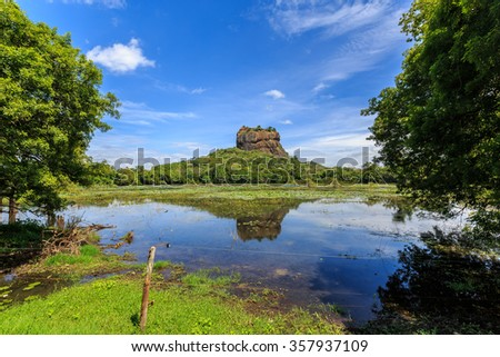 Landscape of lion rock and lake at Sigiriya in Sri Lanka - stock photo