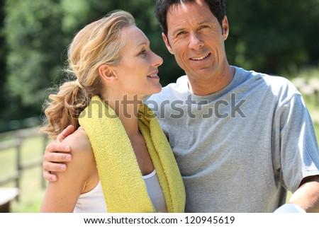 Landscape of mature sporty couple - stock photo