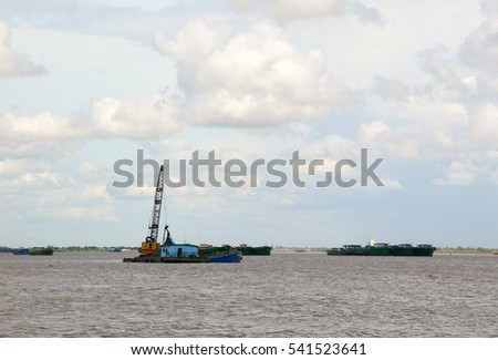 Landscape of Mekong River in Southern Vietnam. A cargo boat carrying sand on the river in Chau Doc, An Giang, Vietnam.