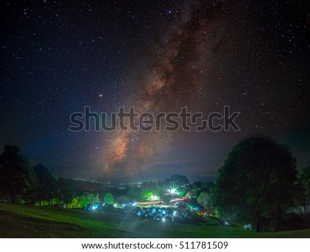 Landscape of Milky way mountain and deep forest at night sky, Doi Samer Dao, Nan province, Thailand