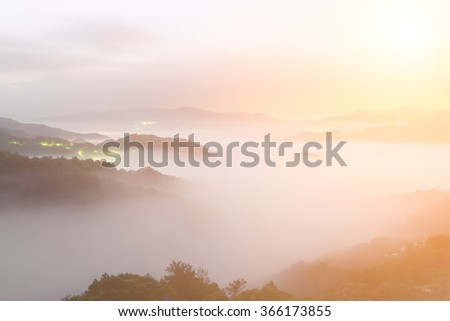 Landscape of mist scenery in hill of rural in dawn. - stock photo