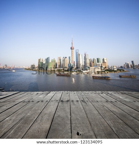 landscape of modern city with wooden floor - stock photo