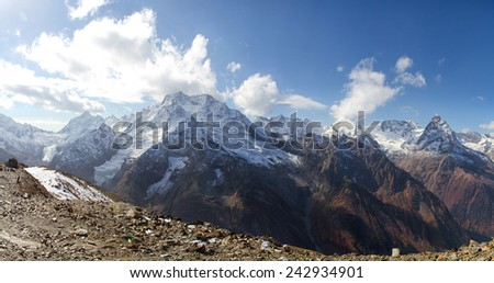 Landscape of mountains Caucasus region in Russia Mountain peaks in clouds. Caucasus. Dombay. - stock photo