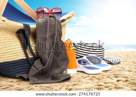 landscape of ocean and beach with brown towel