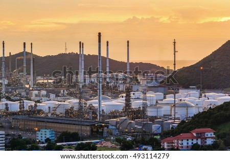 Landscape of oil refinery industry and storage tank with sunset