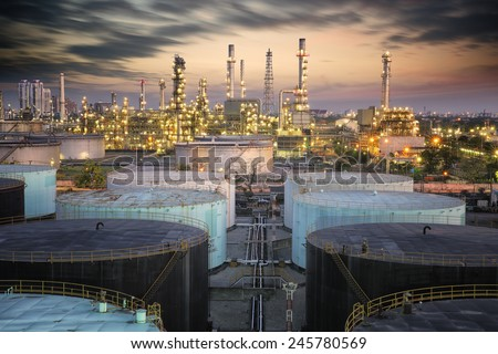 Landscape of oil refinery industry with oil storage tank and pulution environment - stock photo