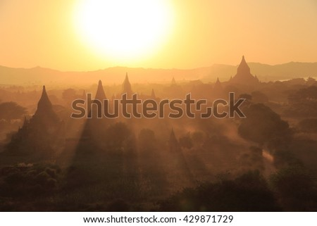 Landscape of pagoda field in the mist during sunset from Swesandaw pagoda, Bagan, Myanmar - stock photo