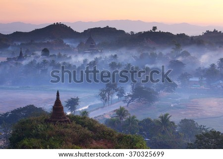 Landscape of pagodas with mist at dawn in Mrauk-U, Myanmar - stock photo
