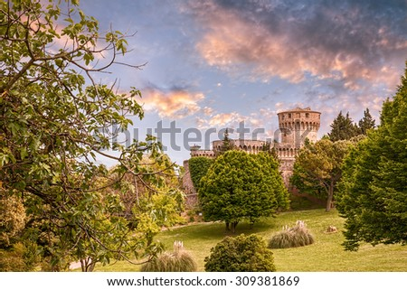 landscape of park with medieval castle in the old town Volterra, Tuscany, Italy - stock photo