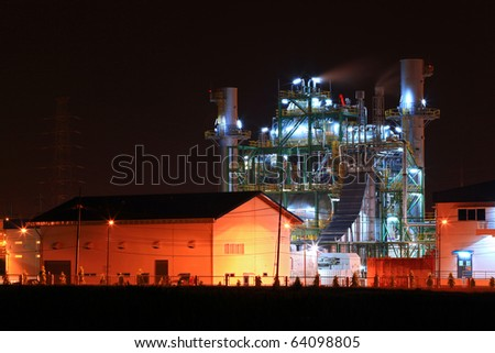 landscape of petrochemical oil refinery plant shines at night