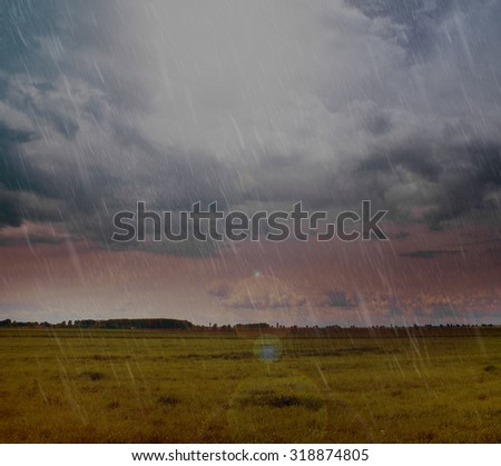 Landscape of rain and clouds over country field